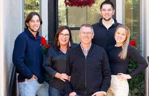 Franchise Owners of Primrose School Jay and Robin Fischer with their family