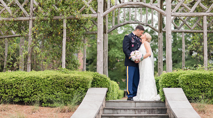 Two Army Officers Wed Underneath A Hand Built Arbor