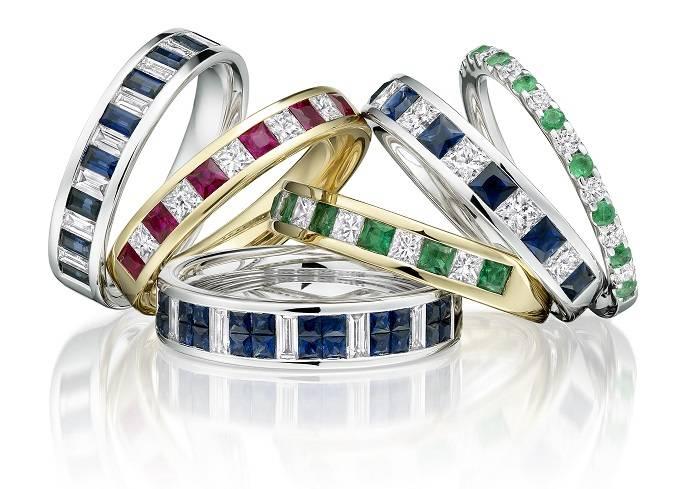Coloured gem set & diamond eternity rings from Pobjoy Diamonds