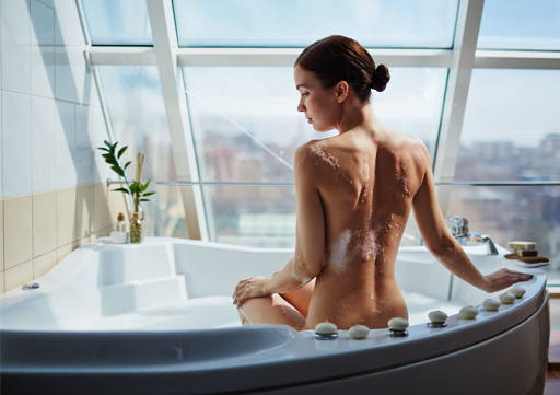 woman in the bath using intimate liquid from Organique natural cosmetics