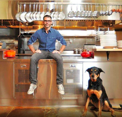 David Steele's success as a restauranteur made him crave more creative business opportunities. He poses here with his dog, Jo Jo.