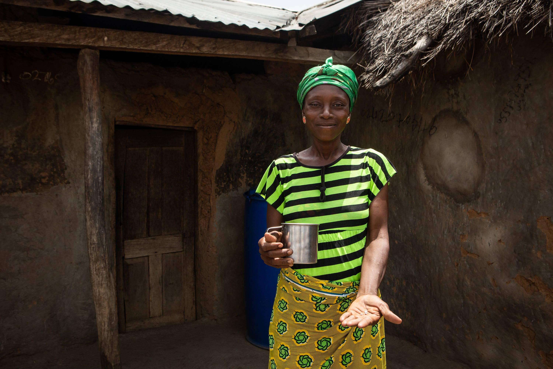 Gmeyenan receives medicine during an MDA in Beposo, Ghana