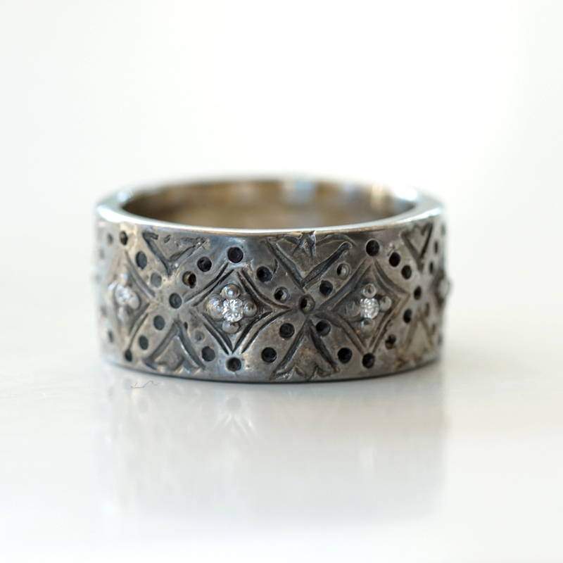 white gold band with back rhodium and diamonds