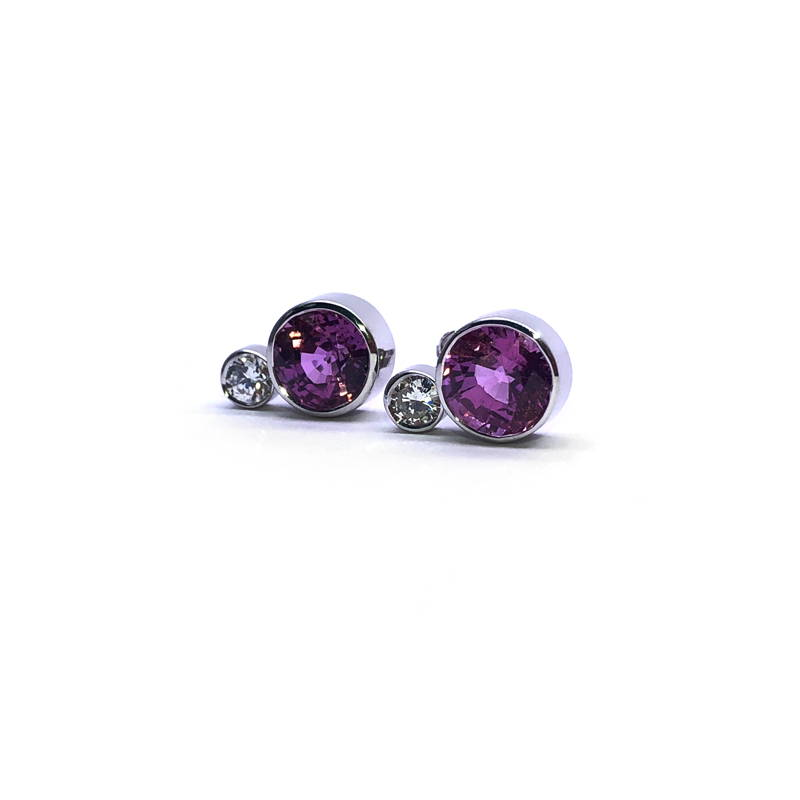 earrings in closed setting of pink sapphire