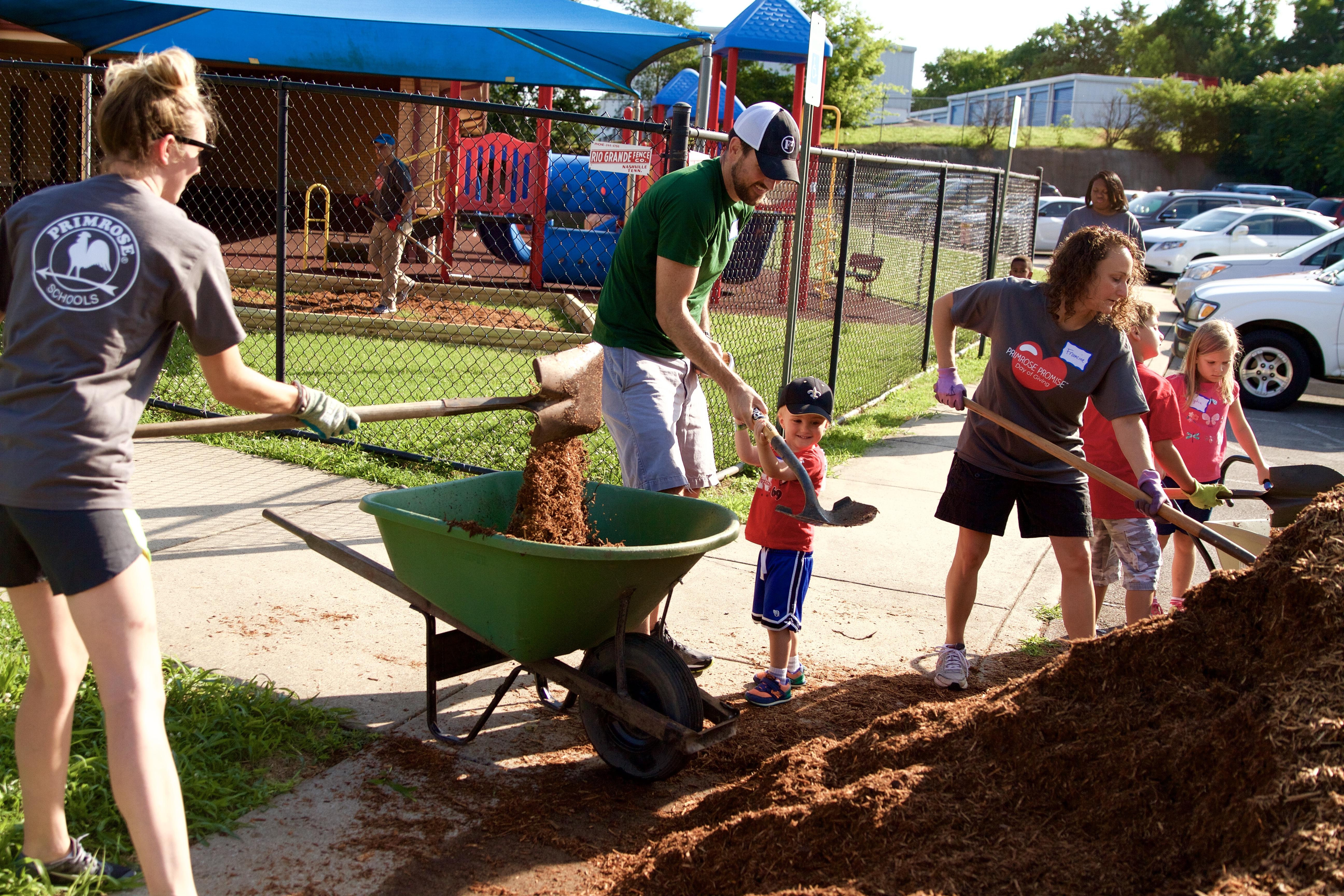 Family shoveling mulch