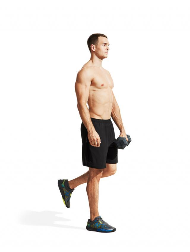 Hold a dumbbell in one hand and stand on the opposite leg