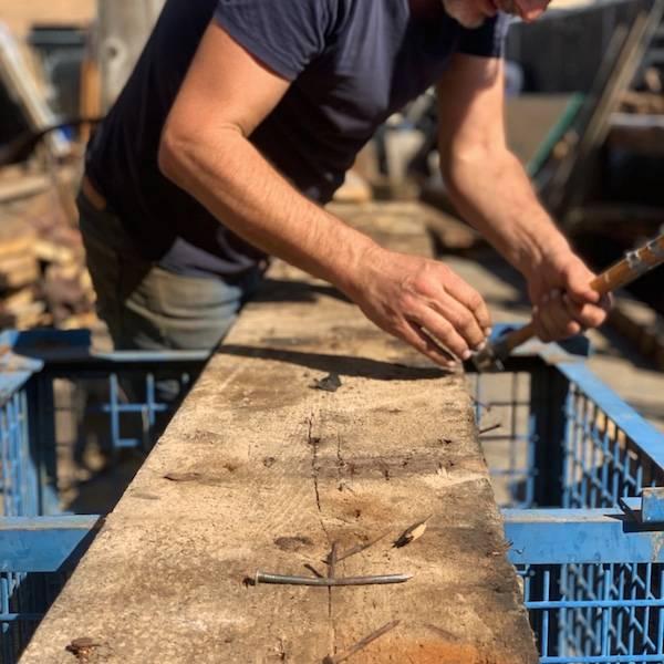 Denailing reclaimed wood from Hahnewald Barn