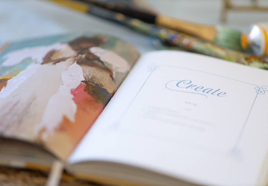 an open book with a colorful angel painting on the left page and a  preview of the text on the right page