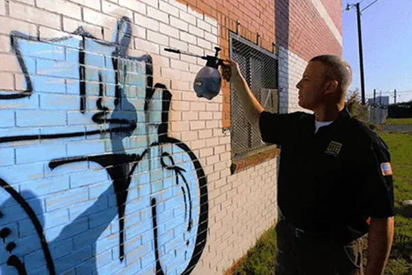 removing graffiti from painted brick