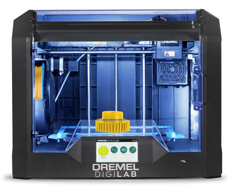 Front image of 3D45-01 3D printer with printed gear on bed, powered on and lit up.