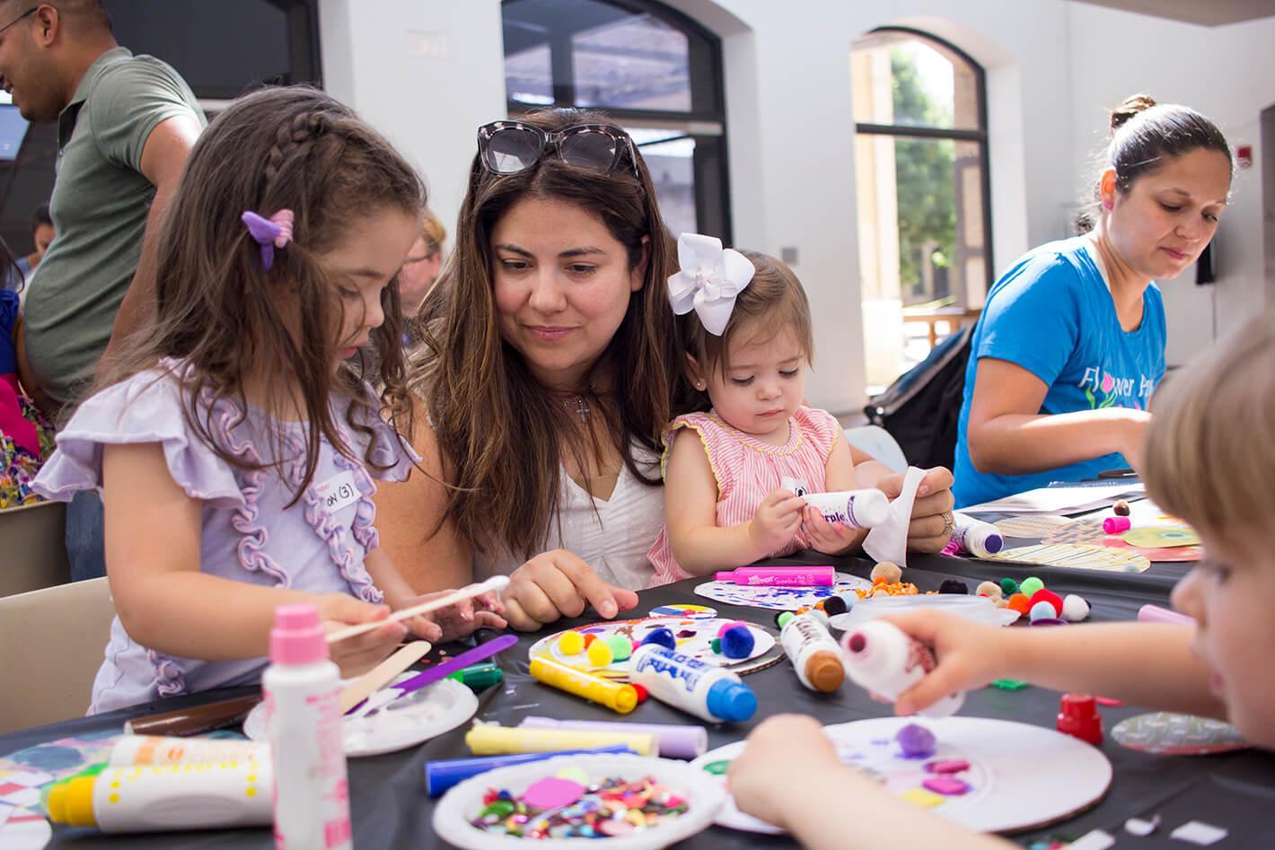 caregiver helping children make art