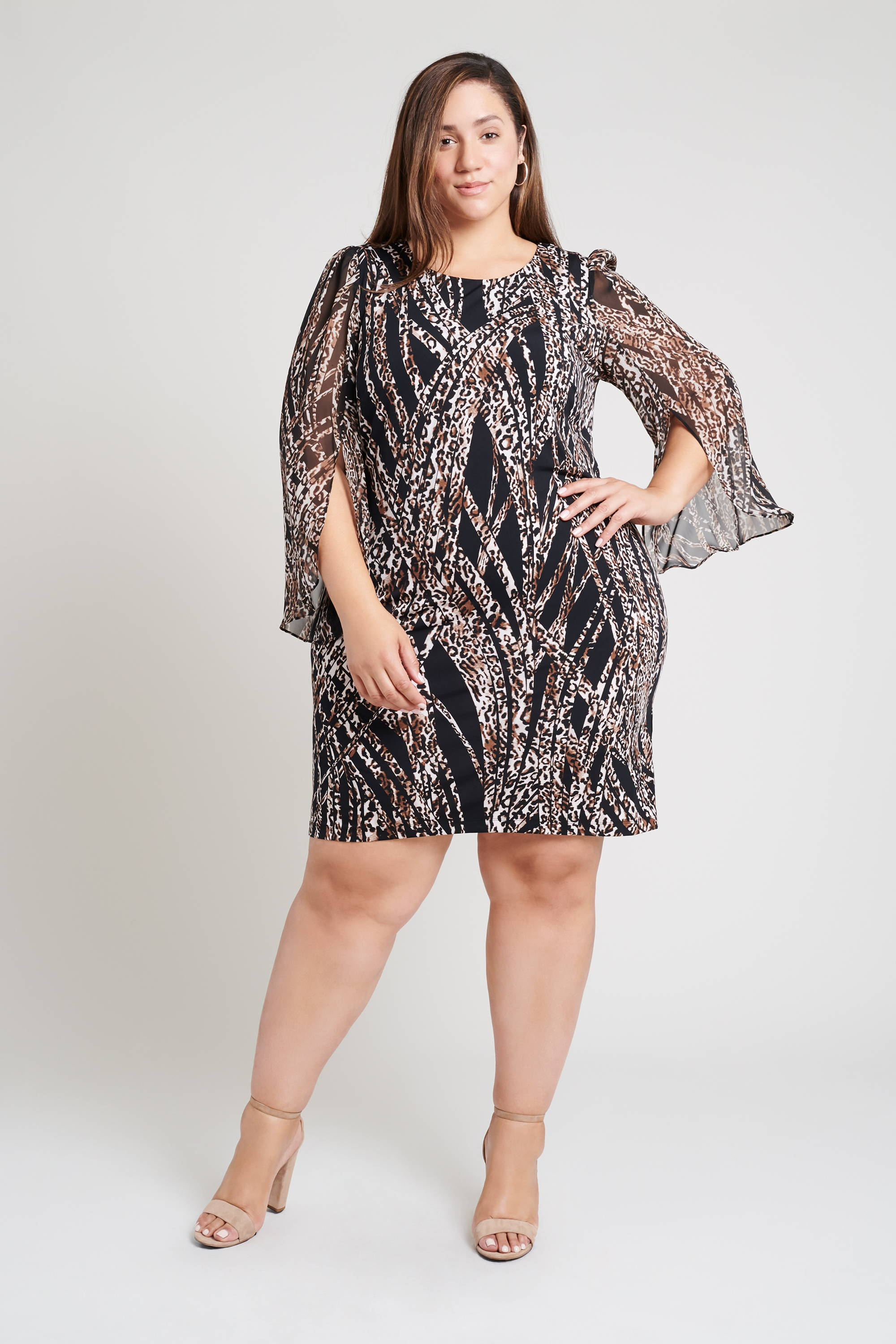 tan brunette long haired plus size woman wearing flirty chiffon sleeve connected apparel black and cheetah print stripe mini dress