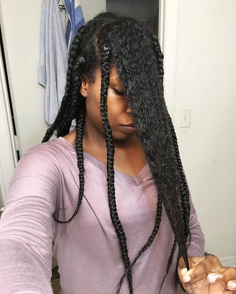 Woman removing braids from natural hair