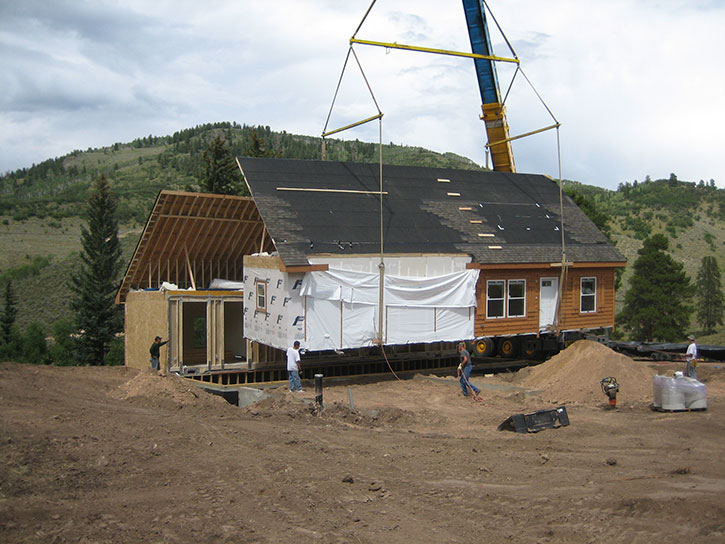 don't get squished under a crane-set modular home