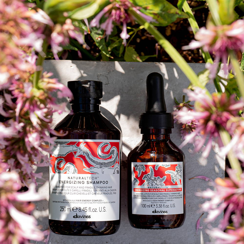 image of Davines products with a pink plant