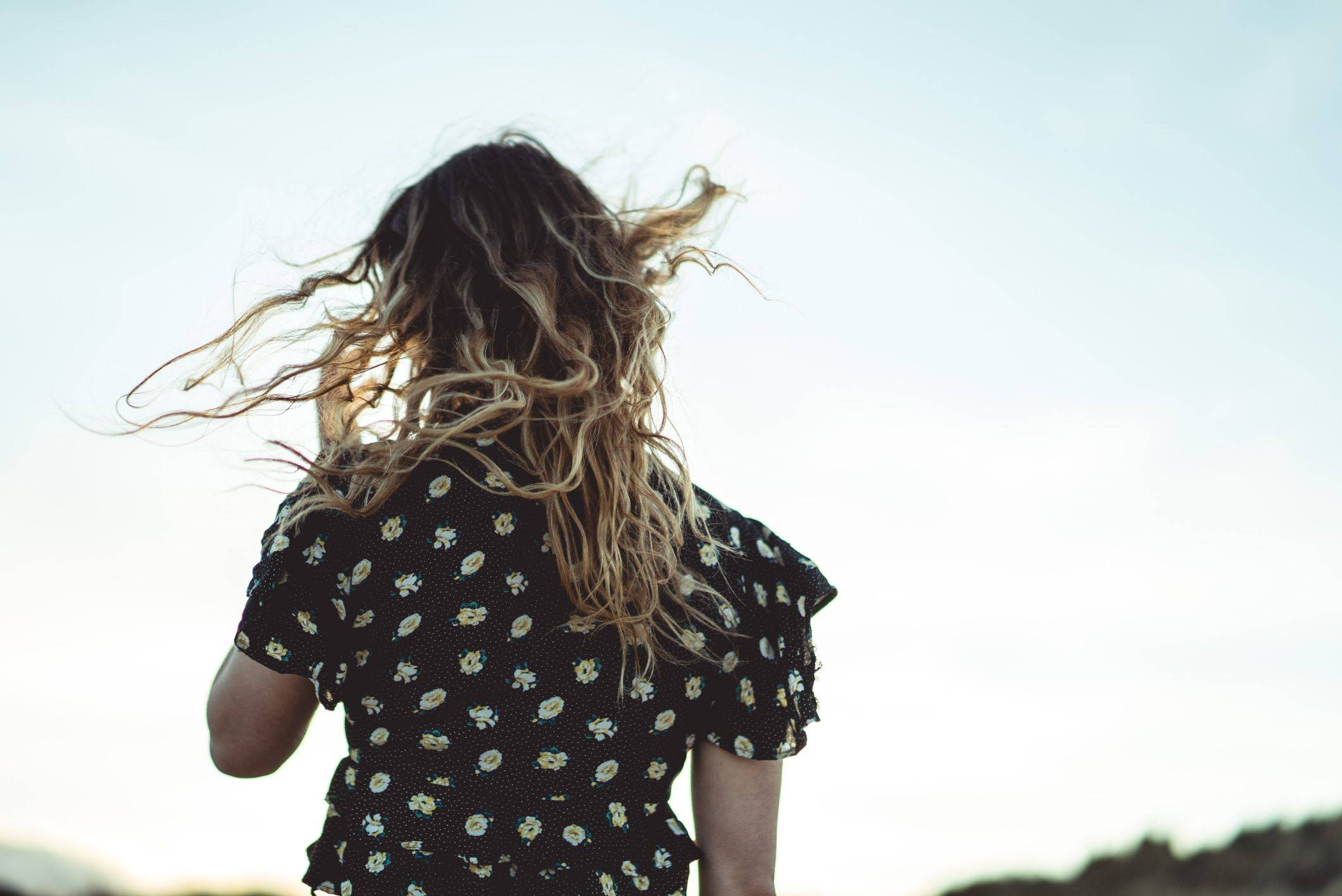 Image of wavy hair blowing in wind