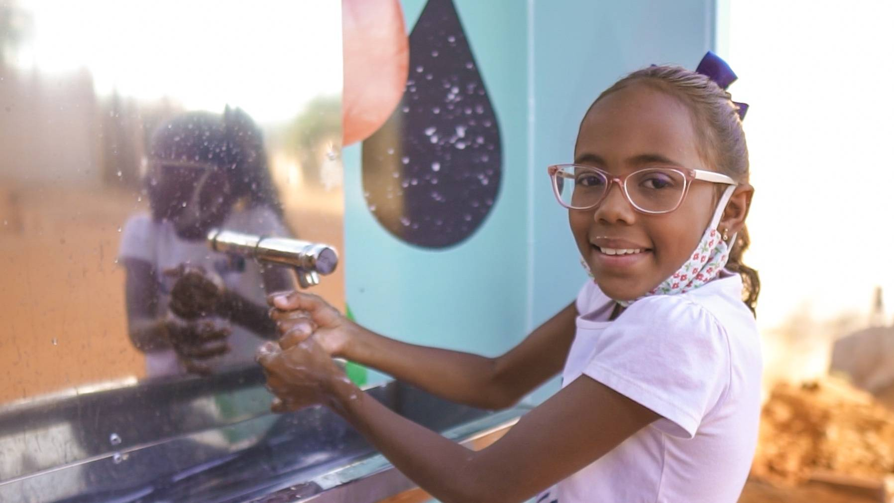 Girl with new Hygiene Station in Brazil