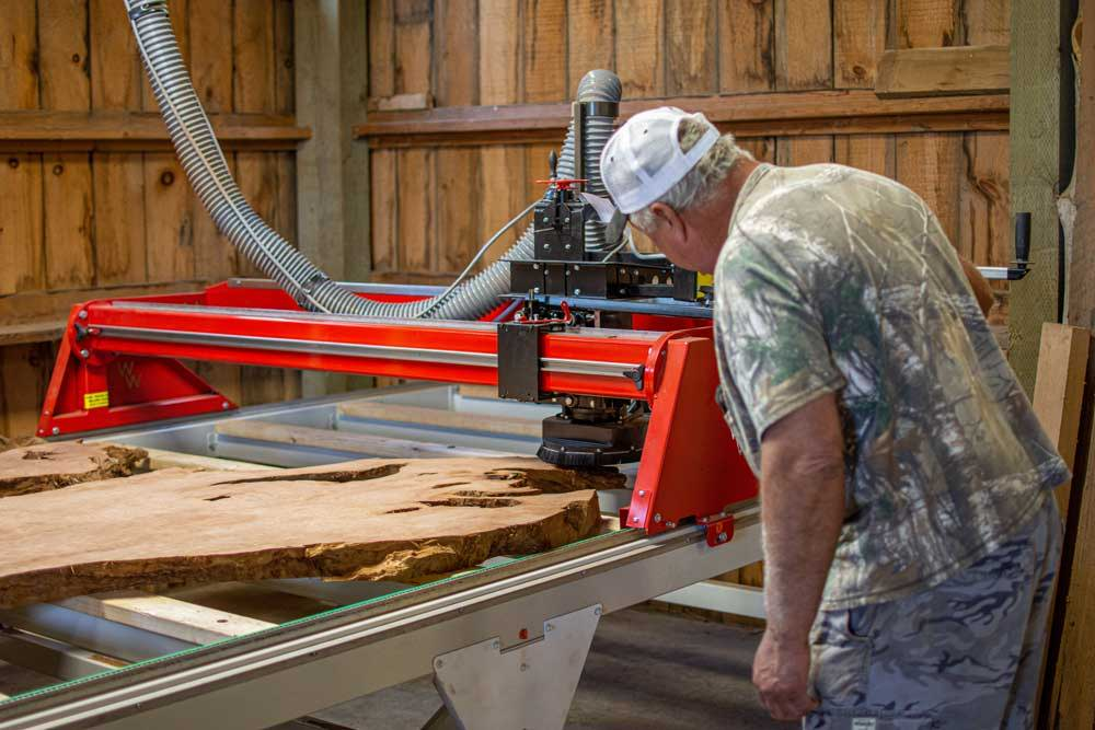 Owner of High West Woods, Irwin Wright working the Wood Wizz Mill