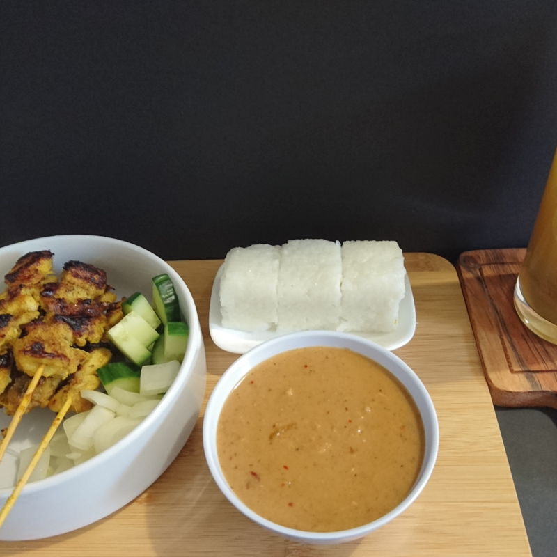 Date: 12 Dec 2019 (Thu) Satay Ayam (Chicken Meat Skewers), Kuah Kacang (Malaysian Satay Peanut Sauce), Nasi Impit (Compressed Rice for Chicken Satay), cucumber, and onions served with apple juice spiked with assam boi.