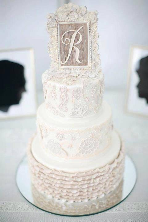 White wedding cake with a small frame on top