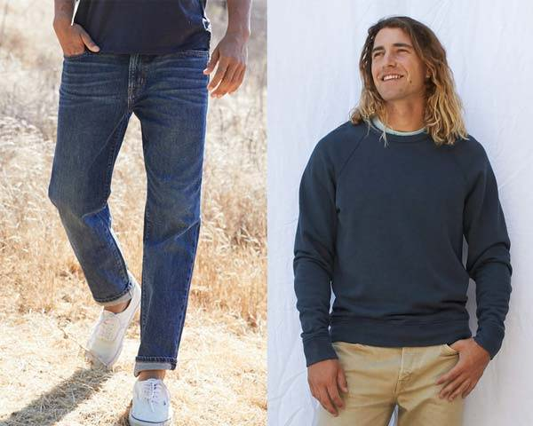 Man wearing organic cotton jeans with white vans trainers and blue tee alongside man wearing organic cotton sweatshirt with chinos both from sustainable menswear brand Outerknown