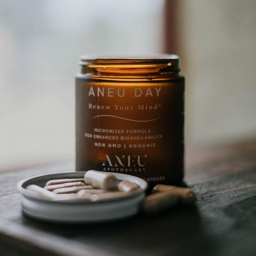 aneu day bottle with capsules in the lid