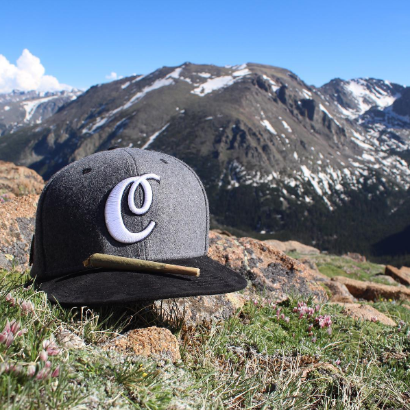 The Cannabist strapback and a cone joint in rocky mountain national park