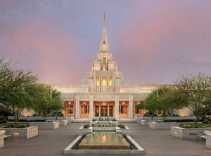 Phoenix temple and grounds in front of pink and purple clouds.