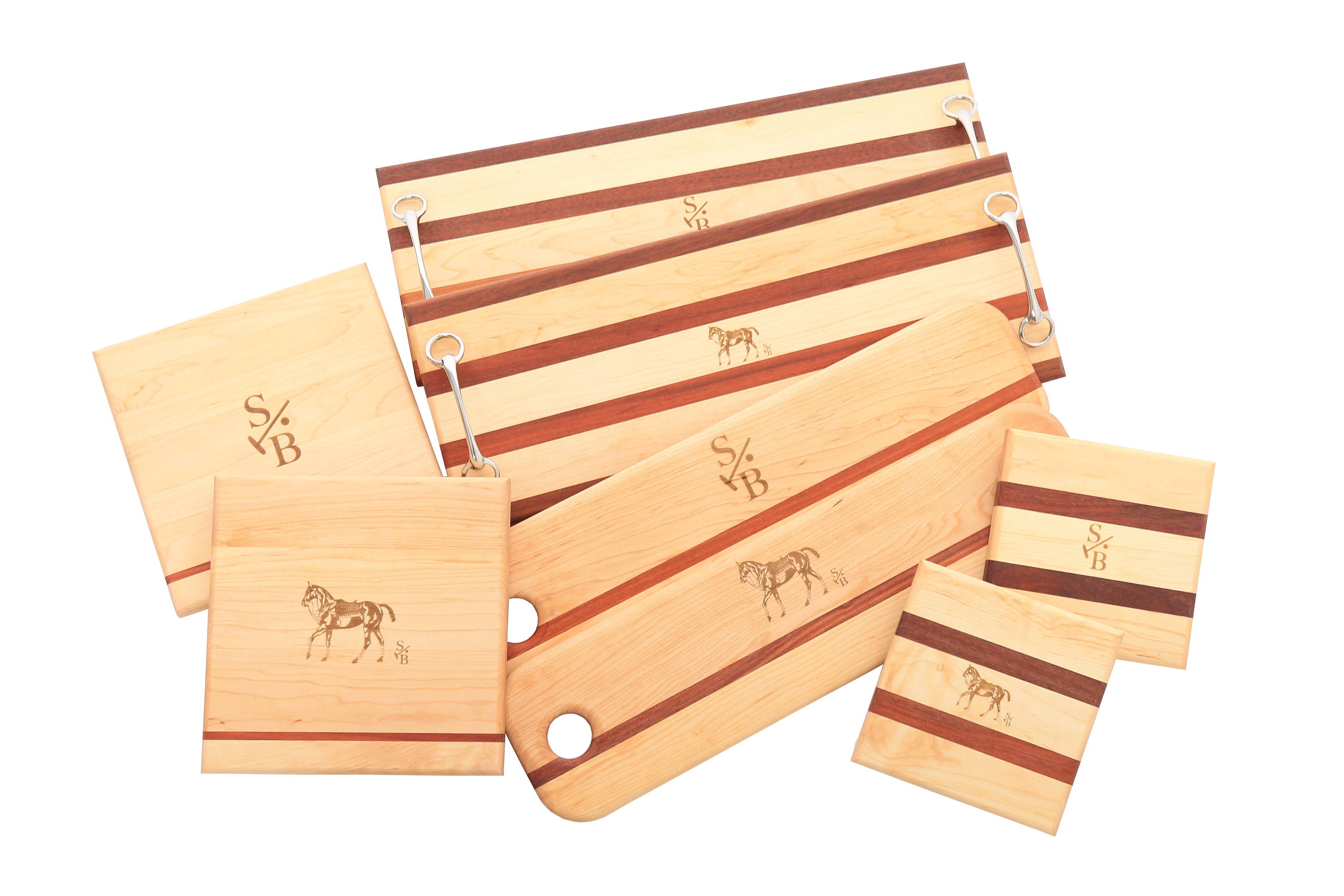 Display of Cheese & Charcuterie Serving Boards with Stick & Ball logo and Polo Pony