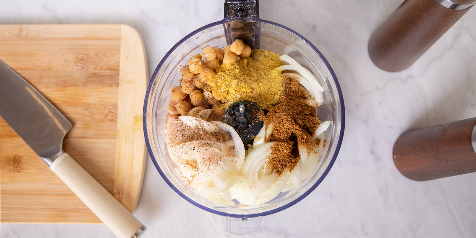 Making hummus at home with a lot of flavor from spices like coriander and cumin.