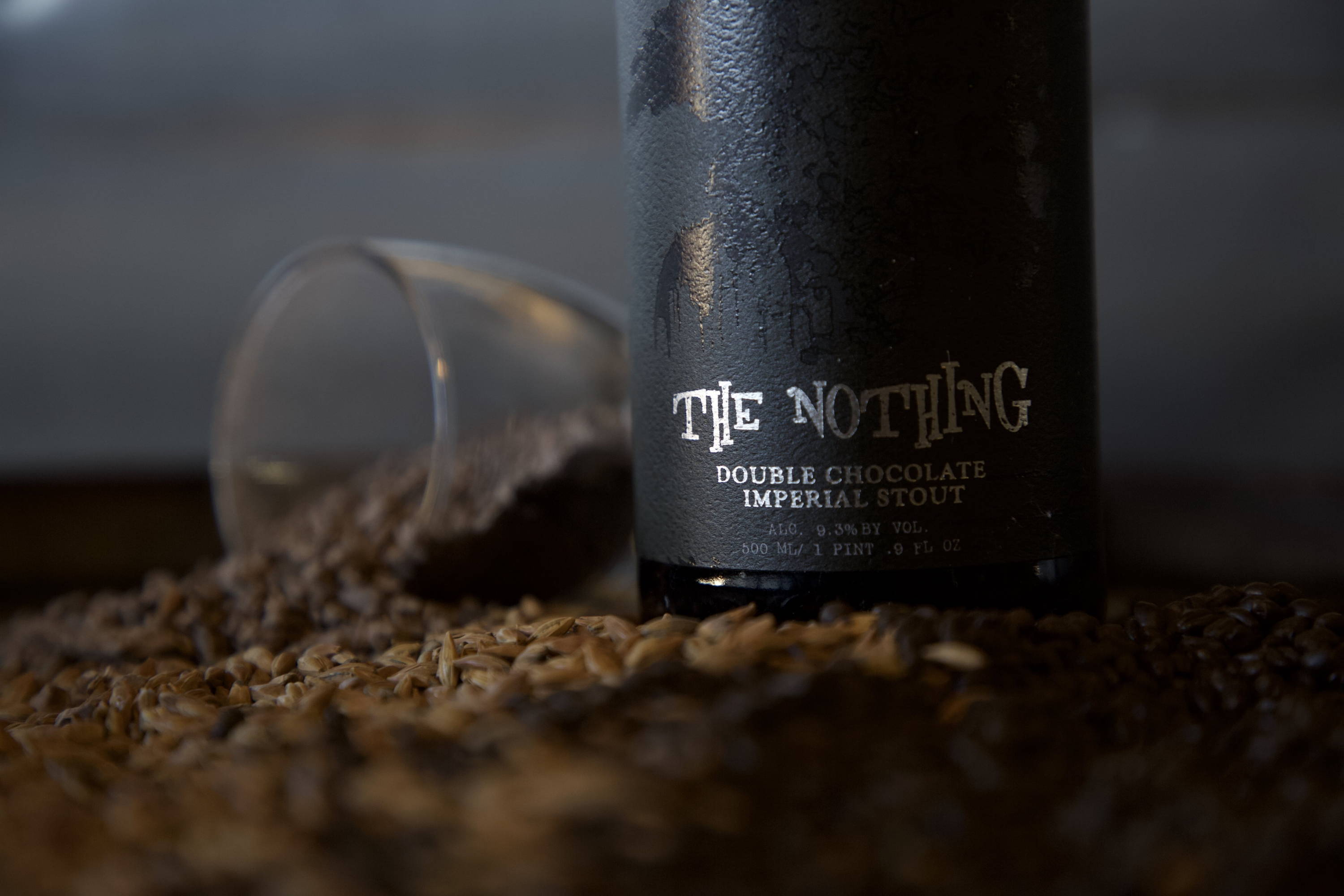 a bottle of the nothing is resting ni a pile of chocolate malts