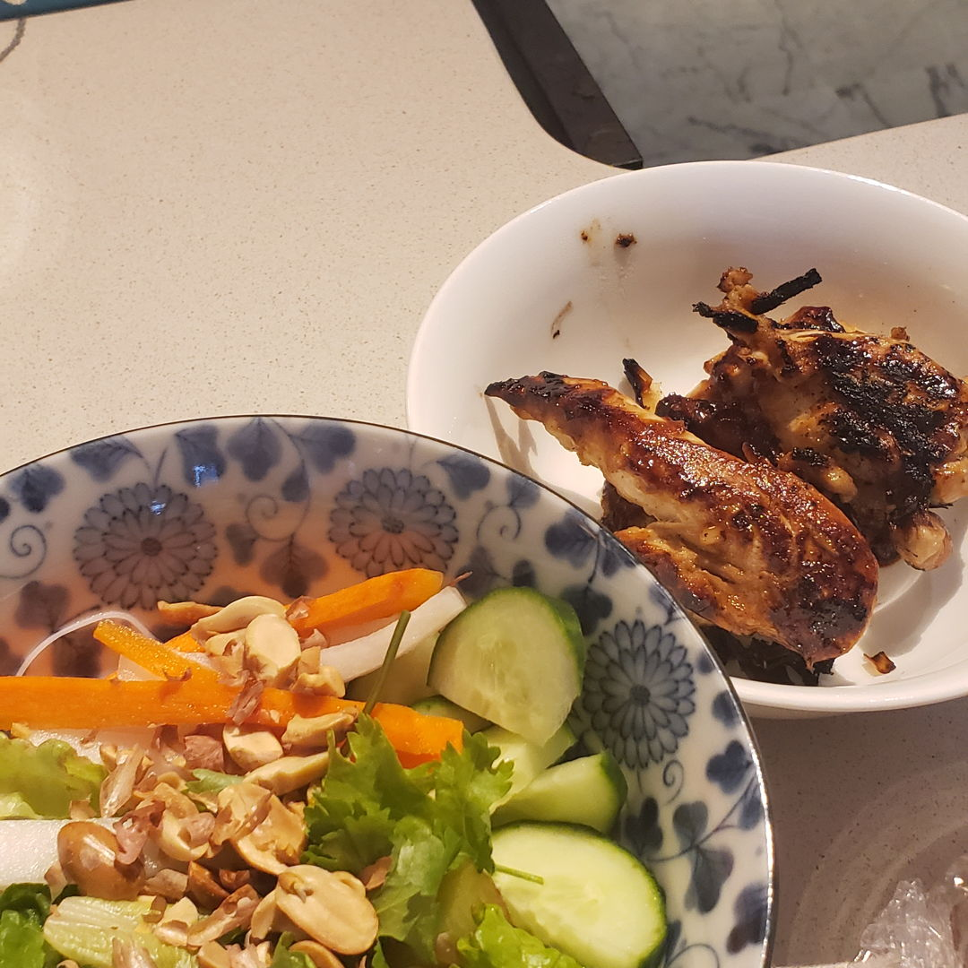 Lemongrass chicken Pickled daikon and carrot  on rice vermicelli  W nuom pak sauce