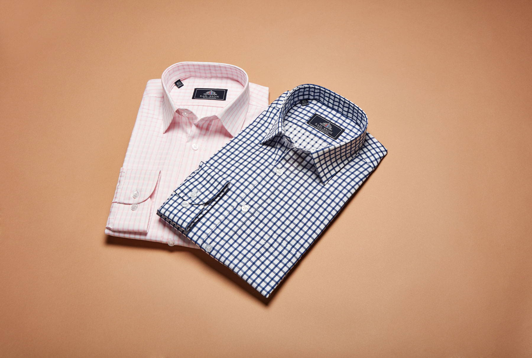 Pink and blue checked shirts laid flat