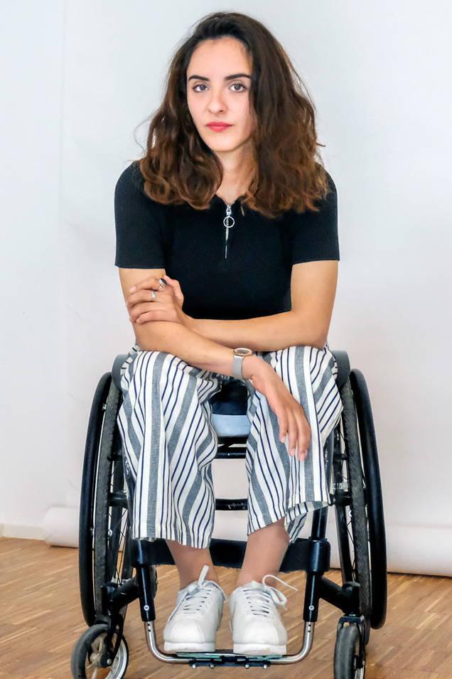 Oksana female founder of the French nonprofit kondor posing in her wheelchair