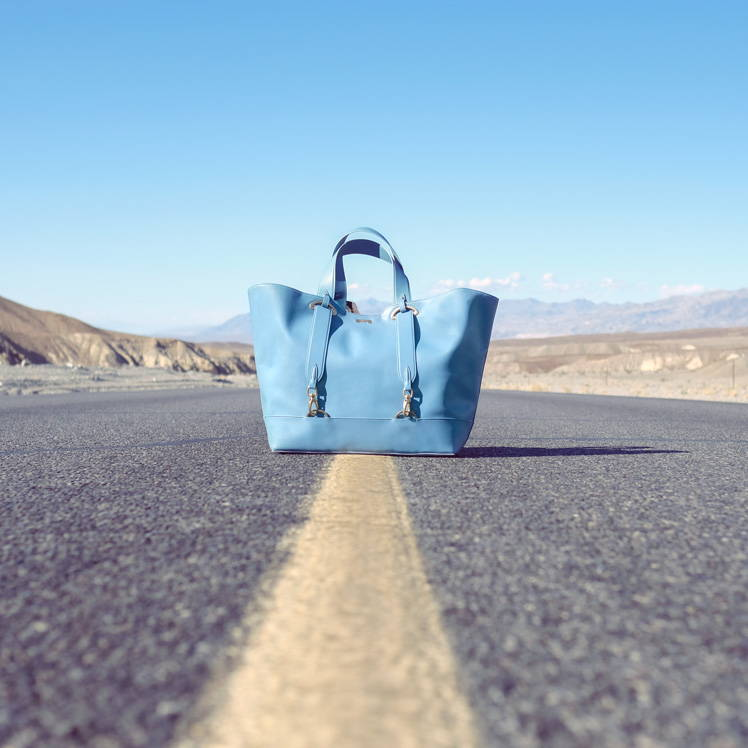 Pastel blue vegan leather oversized shopper for women on the road in the Death Valley, California
