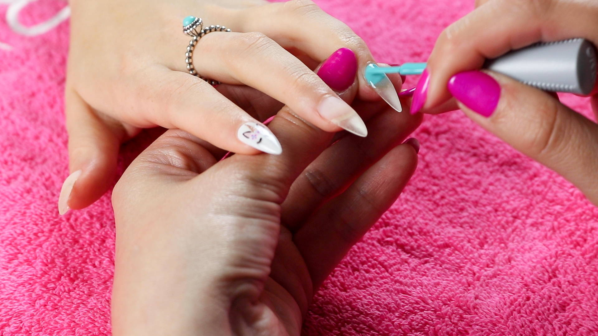 Unicorn nail art detail being painted onto a nail using ORLY GelFX Gumdrop