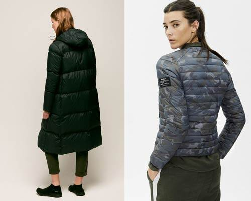 Woman wearing long insulated coat from Ecoalf made from recycled polyester and woman wearing sustainable insulated bomber jacket in blue camouflage