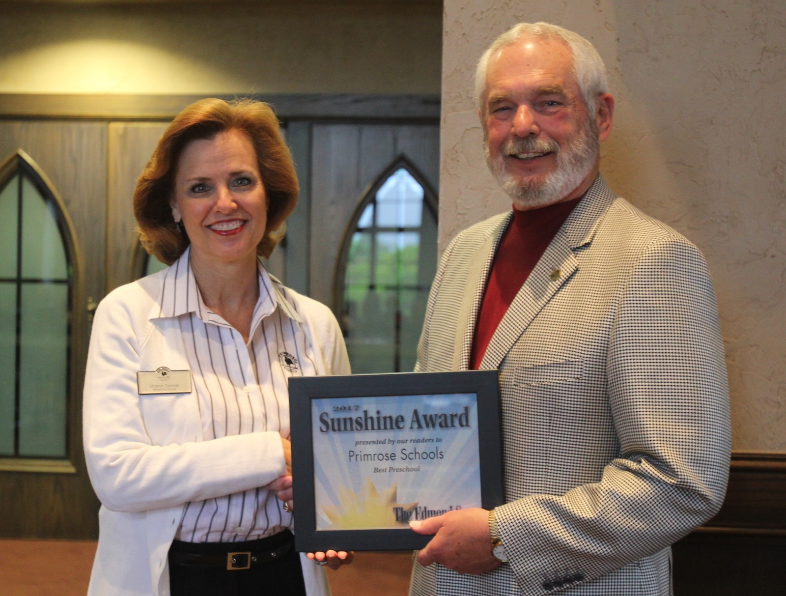 Mrs. Tanner receiving the award from Edmond Mayor, Charles Lamb