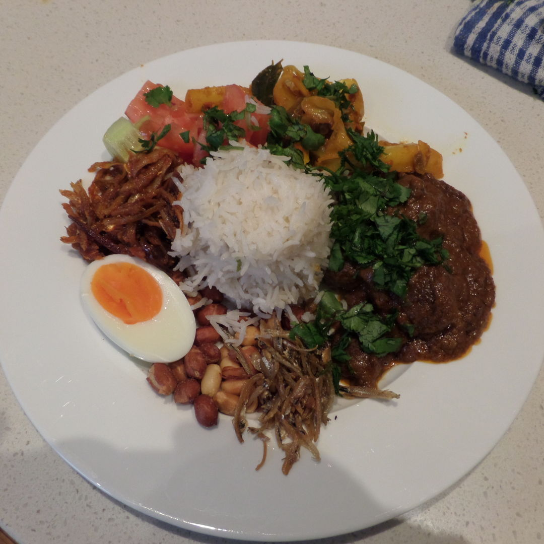 On a cold Melbourne Sunday a Nasi Lemak with Lamb Rendang and a side of Tumeric Cabbage is going to make it warmer.