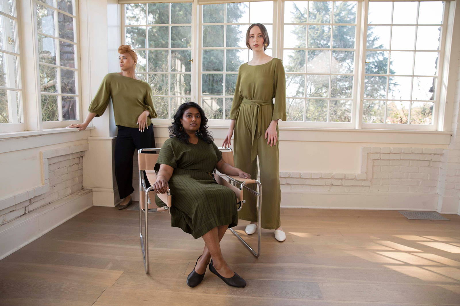 Models wearing the zero waste Hanae collection in moss green