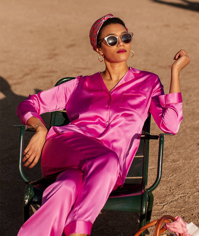 Lena Farl YOLKE Girl wearing pink silk pyjamas