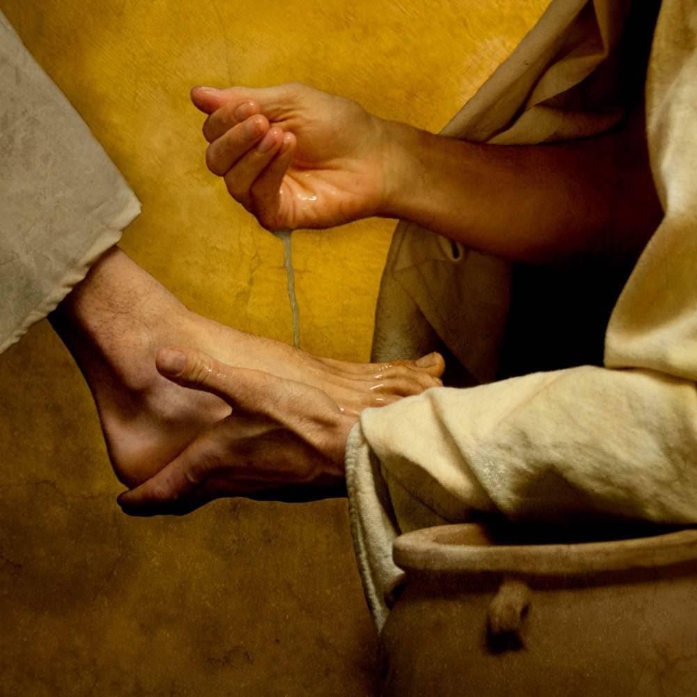 LDS art painting of Jesus Christ washing the apostles' feet.