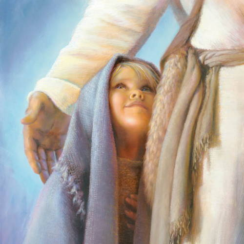 A small child standing under Jesus' arm and smiling up at Him.