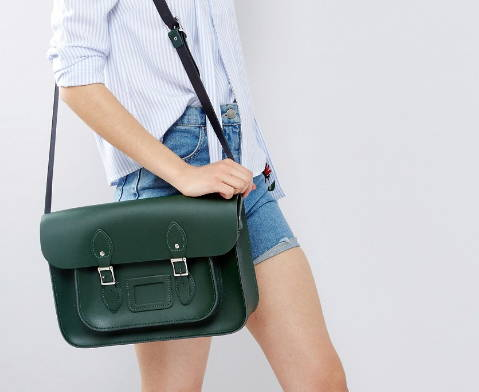 Woman Wearing a Green Leather Briefcase