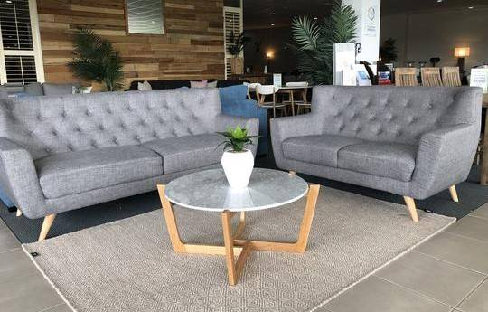 Fabric sofa pair in light grey and round coffee table
