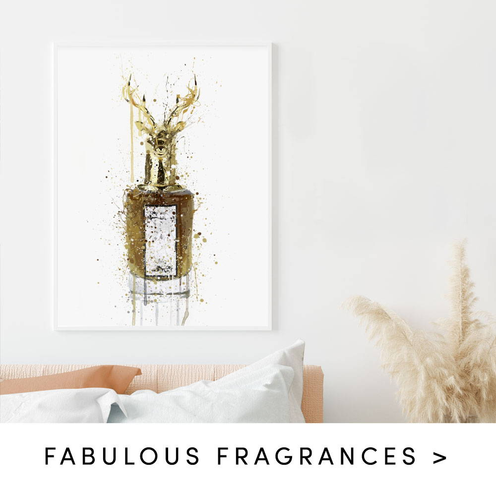 Stag head fragrance splatter wall art print within a bedroom. Text states to shop fabulous fragrances