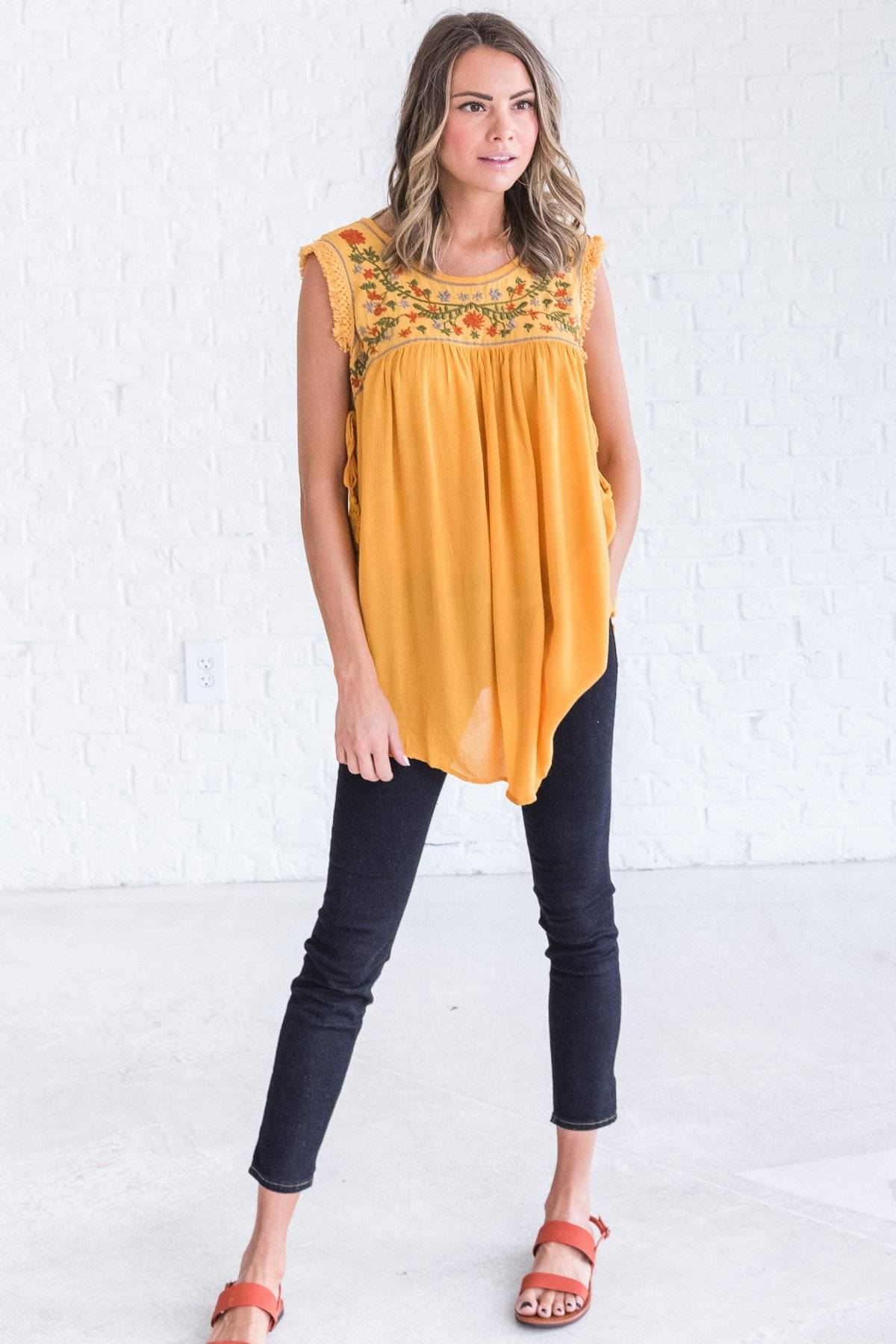 yellow spring top with flowers from bella ella boutique