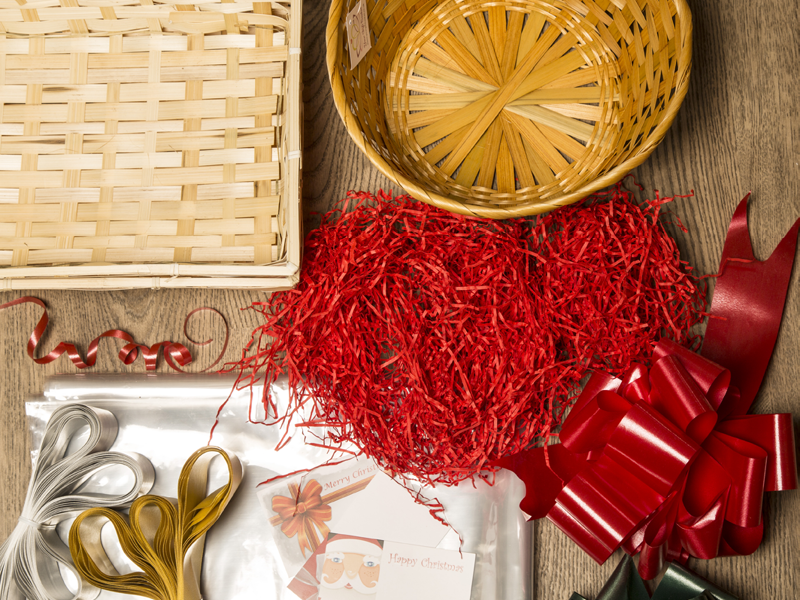 Gift set image of red shred, bow, basket and cellophane