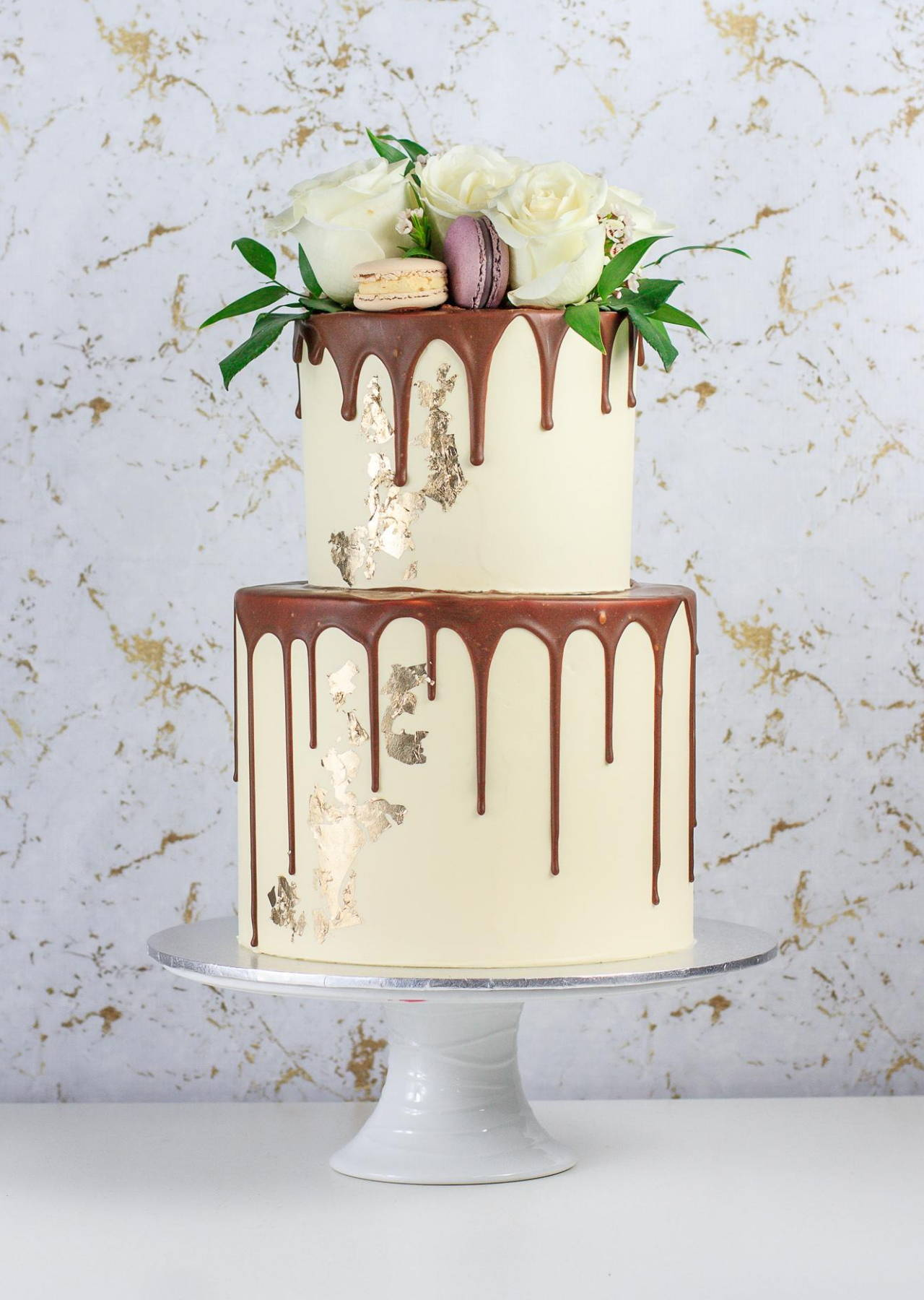 2 Tier Custom Cake with Chocolate Drip, Gold Foil, White Florals and Macarons