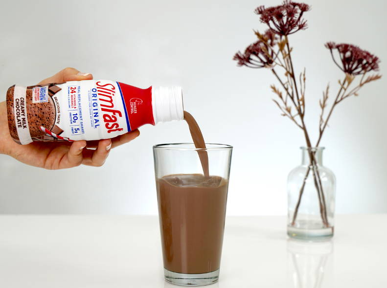 Image of Creamy Milk Chocolate pouring into a glass-lifestyle